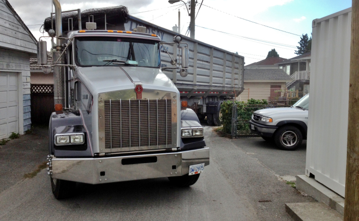 truck maneuvering in tight urban space